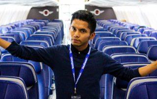 Jezrel Sabaduquia poses on plane