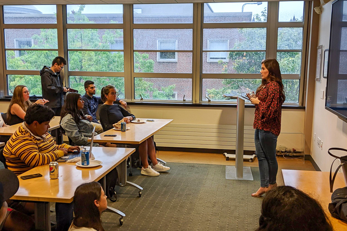Celeste Drumhiller '14 meets with iSchool students at an informational session.