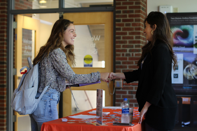 Celeste Drumhiller '14 tables in Hinds Hall to meet with students one-on-one.