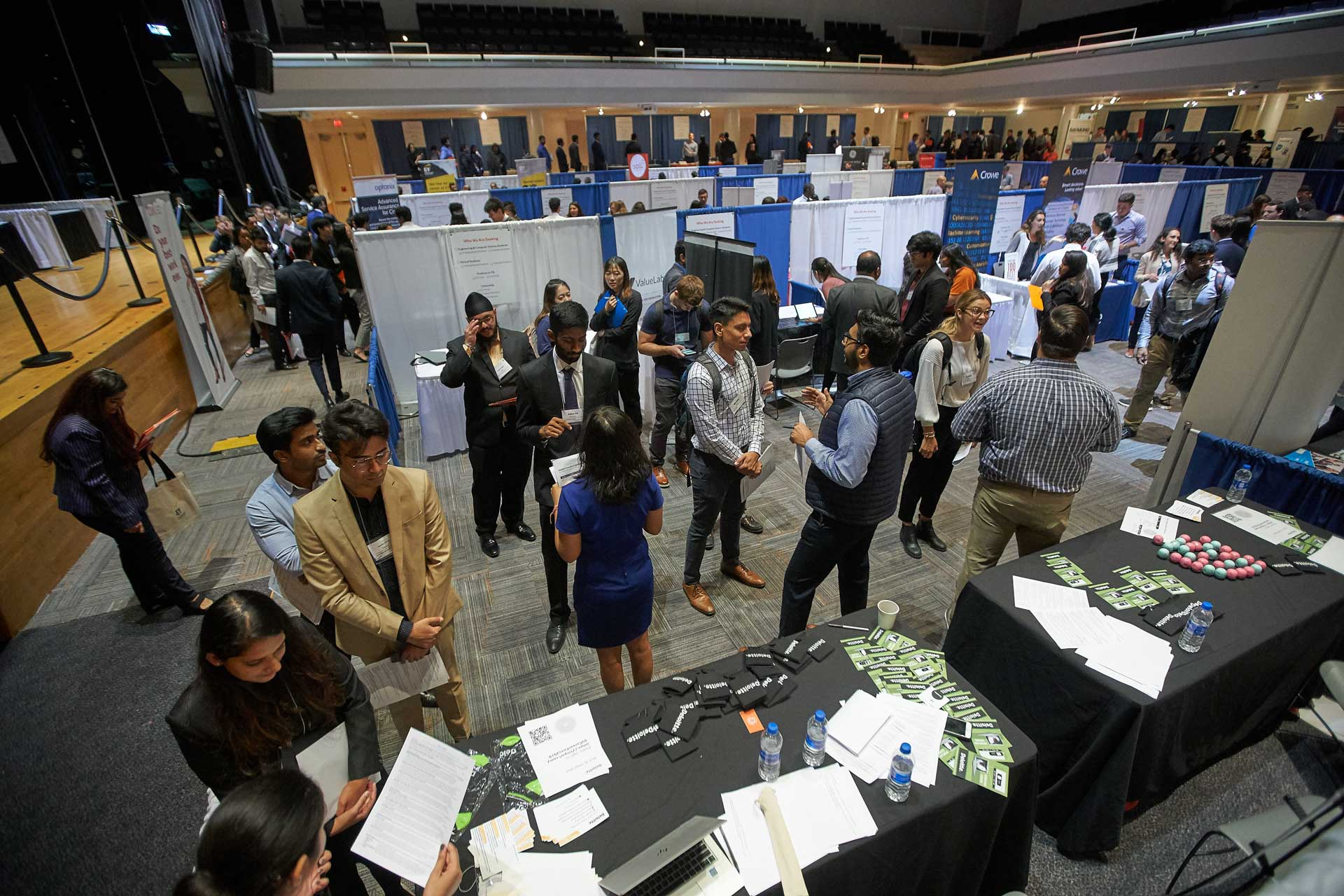 Students and employers mingle at a career fair in Goldstein Auditorium, seen from above