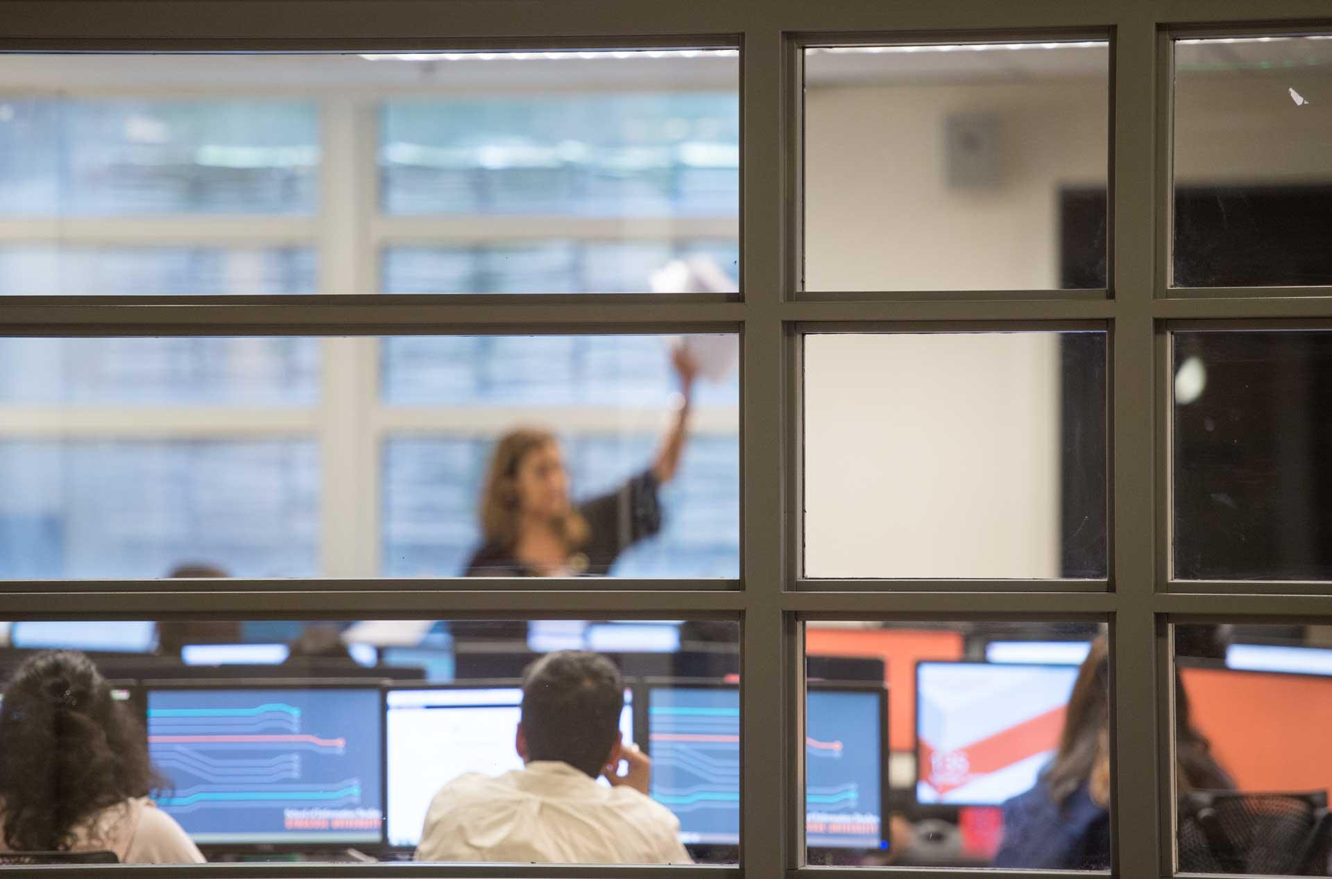 An iSchool class seen through a window