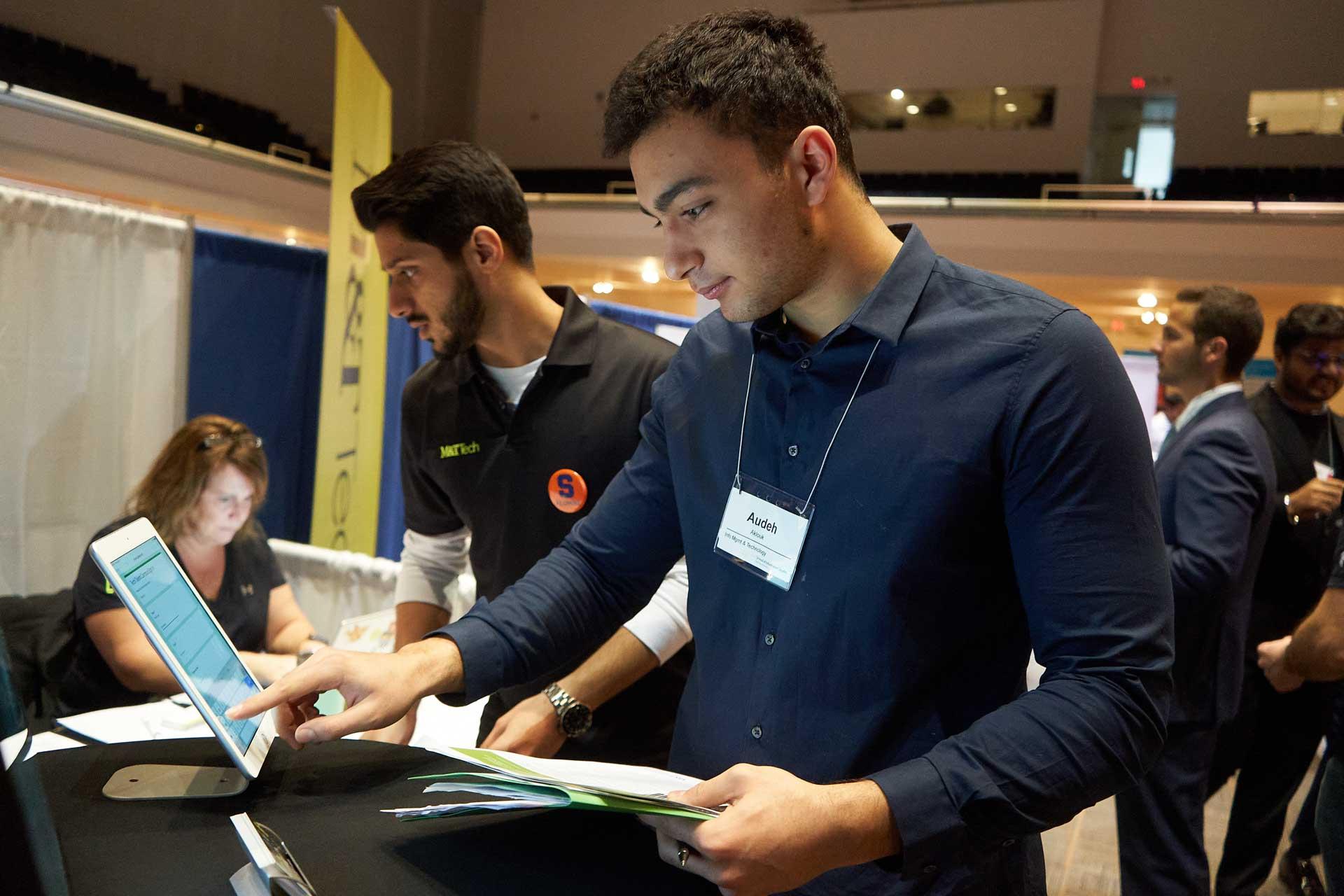 A student attends an iSchool career fair