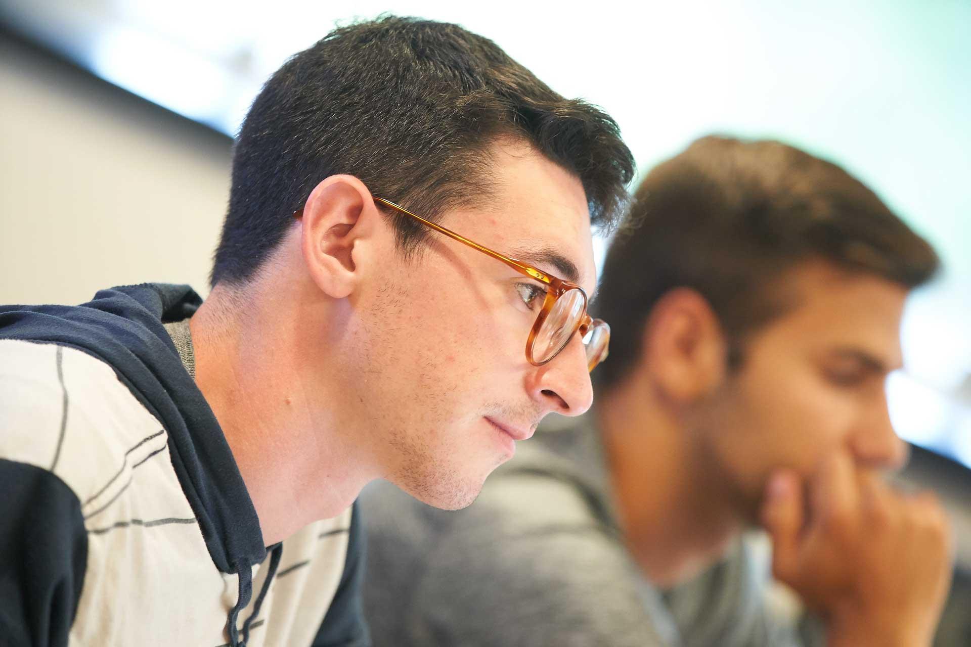 Max Keiser looking at computer screen
