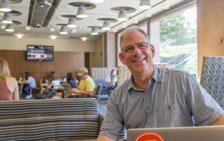 iSchool faculty member Steve Sawyer in Bird Library's Pages Cafe.