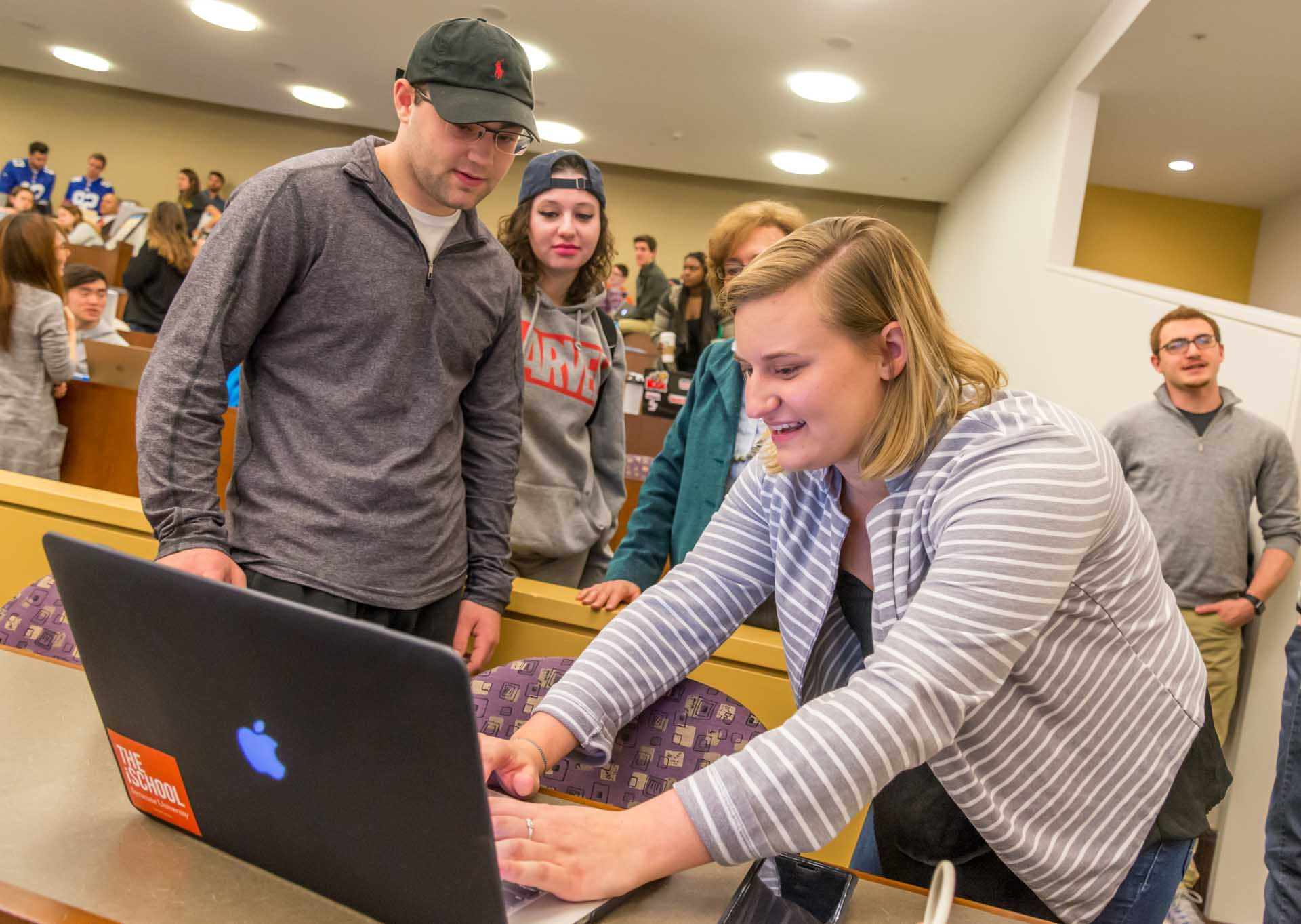 Students being helped at computer in Whitman