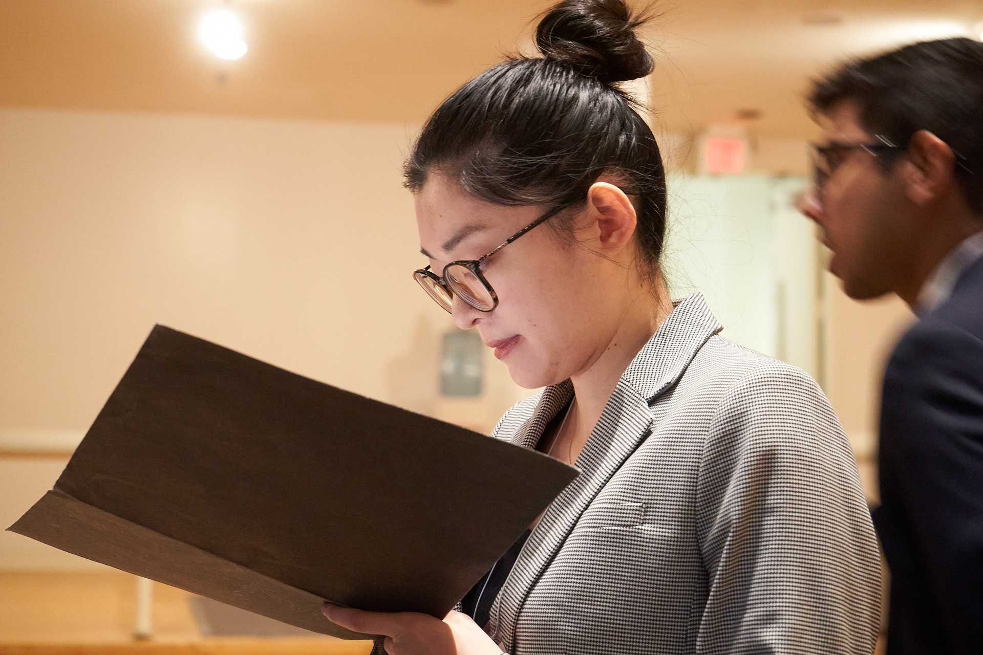 A student consults her paperwork