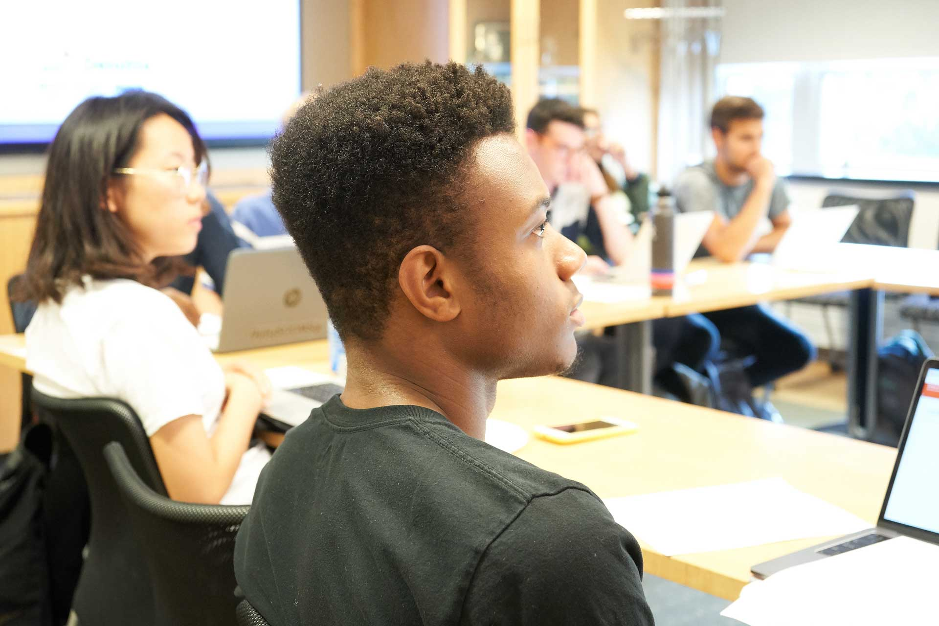 Student looking attentive at lecturer