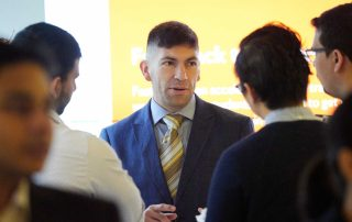 A recruiter speaks with students