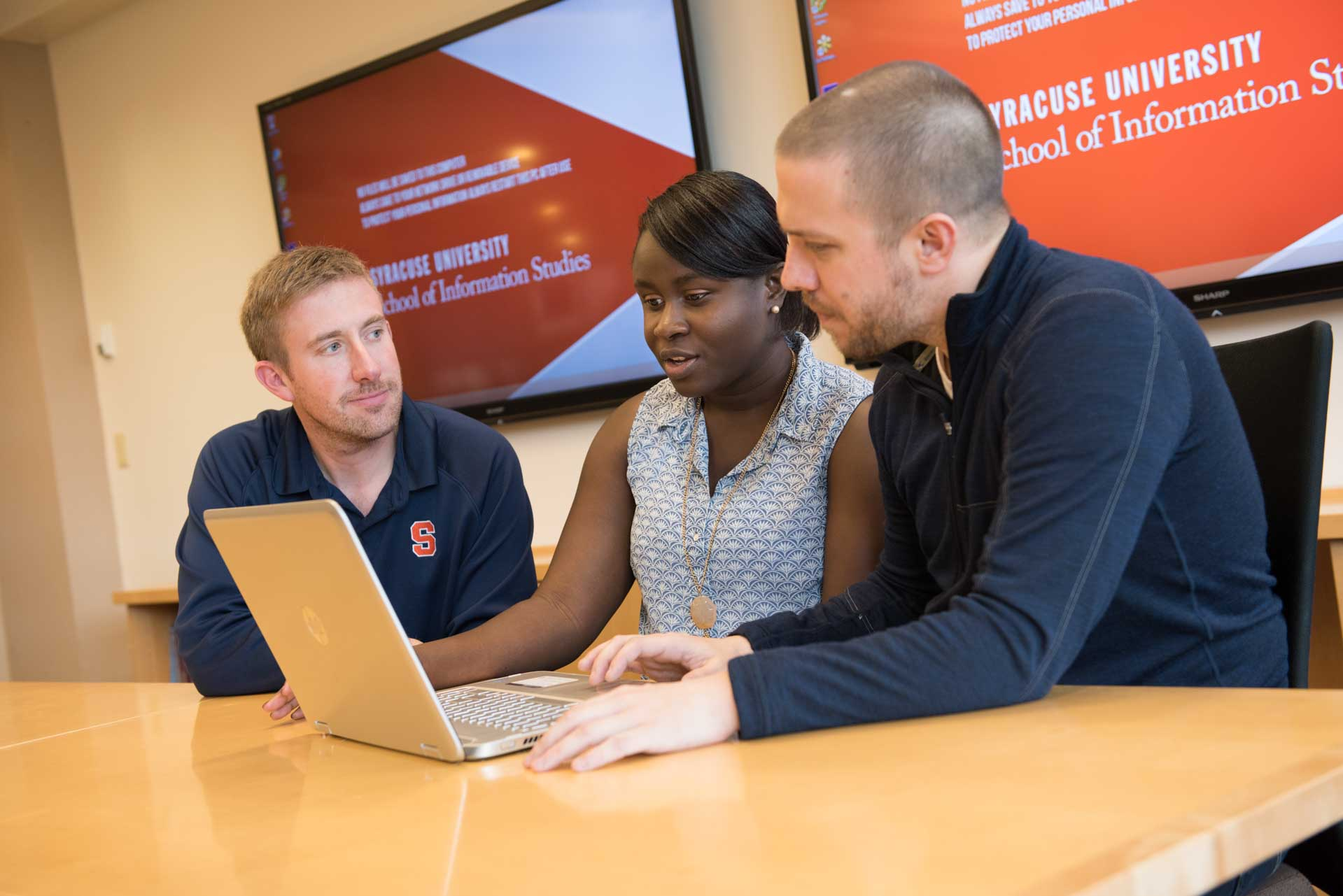 Three students working in Hinds Hall