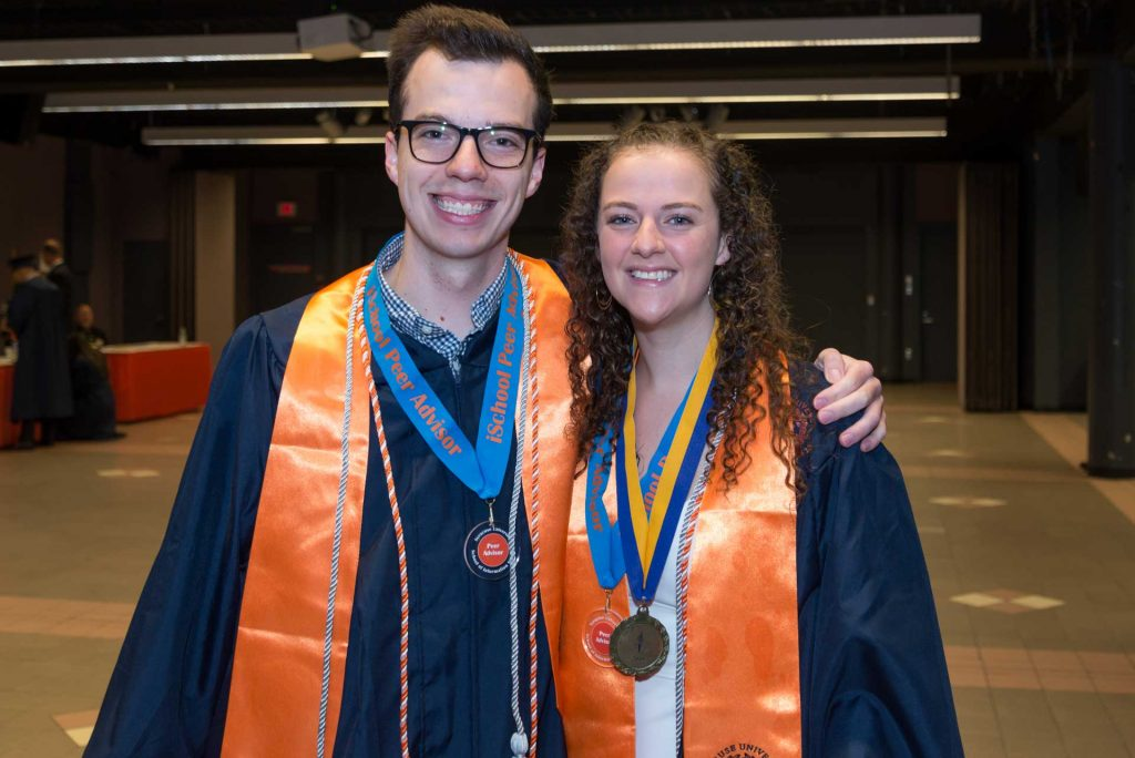 Two students together at 2019 graduation