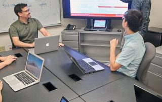 Daniel Acuna works with student researchers