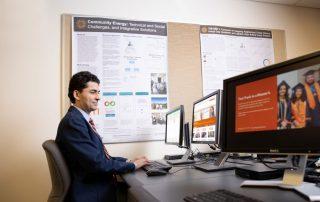 Ehsan Sabaghian sits at a computer